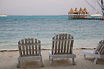 Lounge chairs on the beach at Ramon's Village Resort in San Pedro, Ambergris Caye, Belize