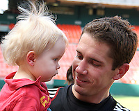 Troy Perkins of DC United with his daughter at a practice session for DC United and AC Milan at RFK Stadium in Washington DC on may 25 2010.