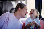 Mother interacting with daughter and both mother and daughter laughing in a RV