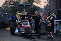 Jun. 30, 2012; Joliet, IL, USA: NHRA crew members for top fuel dragster driver Ike Maier during qualifying for the Route 66 Nationals at Route 66 Raceway. Mandatory Credit: Mark J. Rebilas-