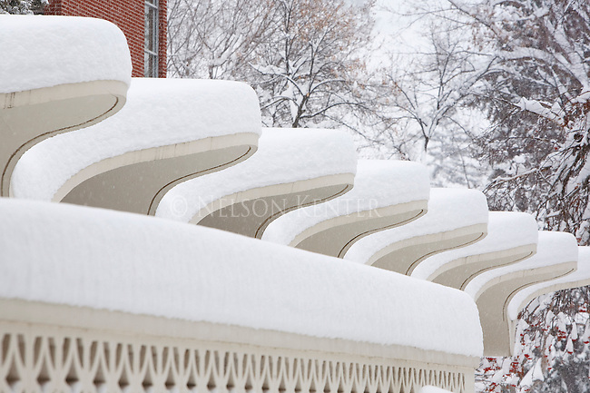 Heavy snow fall covers curving architectural shapes on buildings on the University of Montana campus in Missoula, Montana