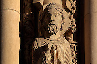 Head of Moses, holding the tablets of the law and wearing a Jewish hat, with 2 plain columns either side where statues have been removed, from the right splay of the left bay of the Royal Portal, 1142-50, Western facade, Chartres cathedral, Eure-et-Loir, France. Chartres cathedral was built 1194-1250 and is a fine example of Gothic architecture. It was declared a UNESCO World Heritage Site in 1979. Picture by Manuel Cohen.