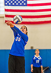 18 October 2015: Yeshiva University Maccabee Middle Blocker Gavriela Colton, a Junior from Teaneck, NJ, bumps during game action against the College of Mount Saint Vincent Dolphins at the Peter Sharp Center, in Riverdale, NY. The Dolphins defeated the Maccabees 3-0 in the NCAA Division III Women's Volleyball Skyline matchup. Mandatory Credit: Ed Wolfstein Photo *** RAW (NEF) Image File Available ***