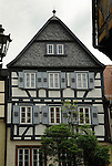 Traditional high gabled roof, wooden facade and window shutters. Schramberg, Black forest, Germany.