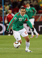 Cuauhtemco Blanco of Mexico in action against France..