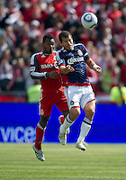 02 April 2011: Chivas USA forward Alejandro Moreno #15 and Toronto FC midfielder Julian de Guzman #6 in action during an MLS game between Chivas USA and the Toronto FC at BMO Field in Toronto, Ontario Canada..The game ended in a 1-1 draw...