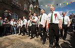 Langholm Common Riding 2016. The symbol of the Spade, symbolises cutting sods with the Common, is held aloft by the towns folk