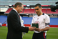 Dr. Bob Contigulia presents Claudio Reyna with a watch in celebration of his 100th National Team Cap, Honduras v USA, 2004.