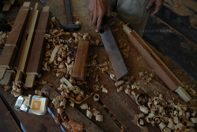 A Vietnamese carpenter works in his home in Hoi An, Vietnam.