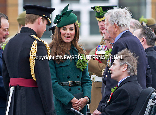 PRINCE WILLIAM AND CATHERINE,  DUCHESS OF CAMBRIDGEvisited the 1st Battalion Irish Guards on St. Patrick's Day Parade at Mons Barracks, Aldershot. <br /> The Duchess of Cambridge presented the traditional sprigs of shamrocks to the Officers and Guardsmen of the Regiment and to Domhnall their Irish Wolf Hound regimental mascot.<br /> The Duke of Cambridge is Colonel of the Regiment_17/03/2014<br /> Mandatory Credit Photo: &copy;Dias/NEWSPIX INTERNATIONAL<br /> <br /> **ALL FEES PAYABLE TO: &quot;NEWSPIX INTERNATIONAL&quot;**<br /> <br /> IMMEDIATE CONFIRMATION OF USAGE REQUIRED:<br /> Newspix International, 31 Chinnery Hill, Bishop's Stortford, ENGLAND CM23 3PS<br /> Tel:+441279 324672  ; Fax: +441279656877<br /> Mobile:  07775681153<br /> e-mail: info@newspixinternational.co.uk