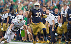 Sept. 26, 2015; Running back Josh Adams breaks away for a 70-yard touchdown in the fourth quarter against the University of Massachusetts at Notre Dame Stadium. (Photo by Barbara Johnston/University of Notre Dame)