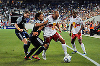 Joel Lindpere (20) of the New York Red Bulls isd marked by Kevin Alston (30) of the New England Revolution. The New York Red Bulls defeated the New England Revolution 2-1 during a Major League Soccer (MLS) match at Red Bull Arena in Harrison, NJ, on June 10, 2011.