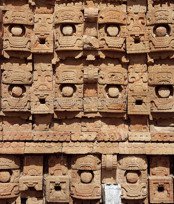 """Detail of the western façade of the Codz Poop (""""Rolled-up matting"""" in Maya), originally covered with 250 stone masks of Chaac, the big-nosed god of rain, Puuc Architecture, 700-900 AD, Kabah, Yucatan, Mexico. Picture by Manuel Cohen"""