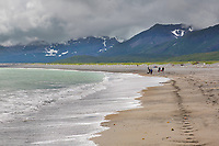 Hiking along the sandy beach of coastal Katmai National Park, Alaska Peninsula, southwest Alaska.