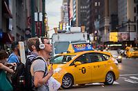 A music listener in Midtown Manhattan in New York wearing his JBL brand headphones on Tuesday, June 7, 2016. (© Richard B. Levine)