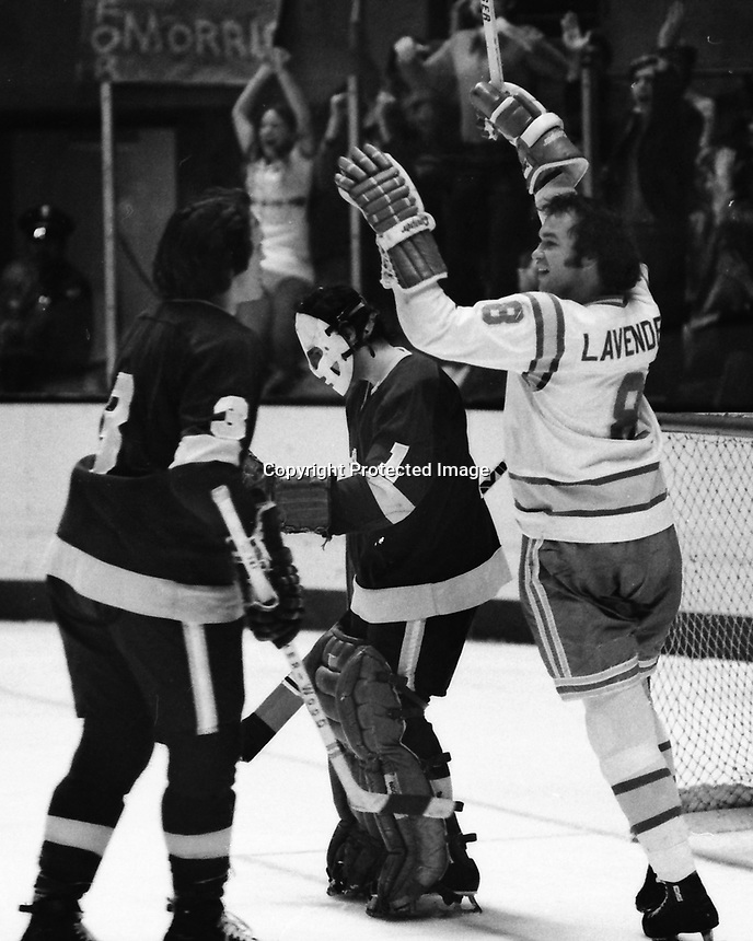 Seals Brian Lavender scores against the Los Angeles Kings goalie Gary Edwards, and #3Larry Brown.<br />
