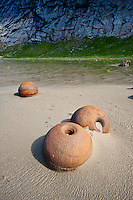 Rusting metal bouys on Bunes beach, Lofoten islands, Norway