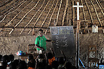 A teacher helps children study basic English in a Catholic Church-sponsored school in the Makpandu refugee camp in Southern Sudan, 44 km north of Yambio, where more that 4,000 people took refuge in late 2008 when the Lord's Resistance Army attacked their communities inside the Democratic Republic of the Congo. Attacks by the LRA inside Southern Sudan and in the neighboring DRC and Central African Republic have displaced tens of thousands of people, and many worry the attacks will increase as the government in Khartoum uses the LRA to destabilize Southern Sudan, where people are scheduled to vote on independence in January 2011. Catholic pastoral workers have accompanied the people of this camp from the beginning.