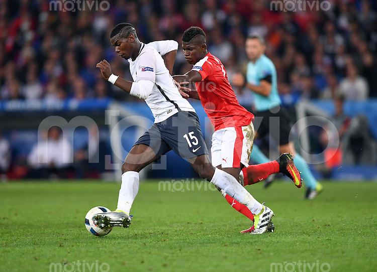 FUSSBALL EURO 2016 GRUPPE A IN LILLE Schweiz - Frankreich     19.06.2016 Paul Pogba (li, Frankreich) gegen Breel Embolo (re, Schweiz)