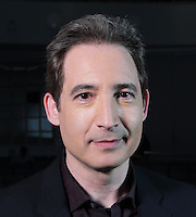 New York, NY, USA - May 10, 2011: Prof. Brian Greene (born February 9, 1963) is an American theoretical physicist and string theorist. He has been a professor at Columbia University since 1996. This photo was taken when he visited his alma mater, Stuyvesant High School in New York.