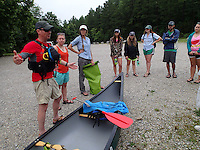 NWA Democrat-Gazette/FLIP PUTTHOFF<br /> William Dupree (from left) and Hannah Spencer with Pack Rat Outdoor Center in Fayetteville offer paddling and safety instruction before the trip July 8 2015. Courtney Thomas with the Beaver Watershed Alliance (third from left) coordinated the trip.