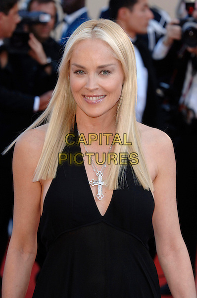 """SHARON STONE.""""Marie Antoinette"""" premiere screening.59th International Cannes Film Festival, France.24th May 2006.Ref: PL.half length black dress cross crucifix necklace.www.capitalpictures.com.sales@capitalpictures.com.©Phil Loftus/Capital Pictures"""