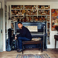 Painter John Dowd in the music room of his cottage in Provincetown, Massachusetts