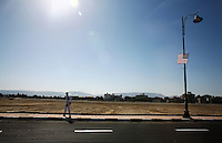 A member of the tourism police stands guard every 100 feet on the road leading to the entry to the Mubarak Stadium before the FIFA Under 20 World Cup Group C Match between the United States and Germany at the  on September 26, 2009 in Suez, Egypt. The US lost to Germany 3-0.