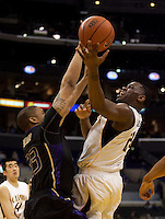 Theo Robertson tries to shoot the ball over C.J. Wilcox. The Washington Huskies defeated the California Golden Bears 79-75 during the championship game of the Pacific Life Pac-10 Conference Tournament at Staples Center in Los Angeles, California on March 13th, 2010.
