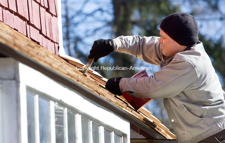 WOODBURY, CT- 17 MARCH 2008- 031708JT01-<br /> <br /> Dave Sipperly applies sealer to a new roof at 451 Main St. South, which has been under restoration for the past 10 years, and is home to Tucker Frey, Robert Walin, and Autumn Pond Antiques in Woodbury on Monday.<br /> Josalee Thrift / Republican-American