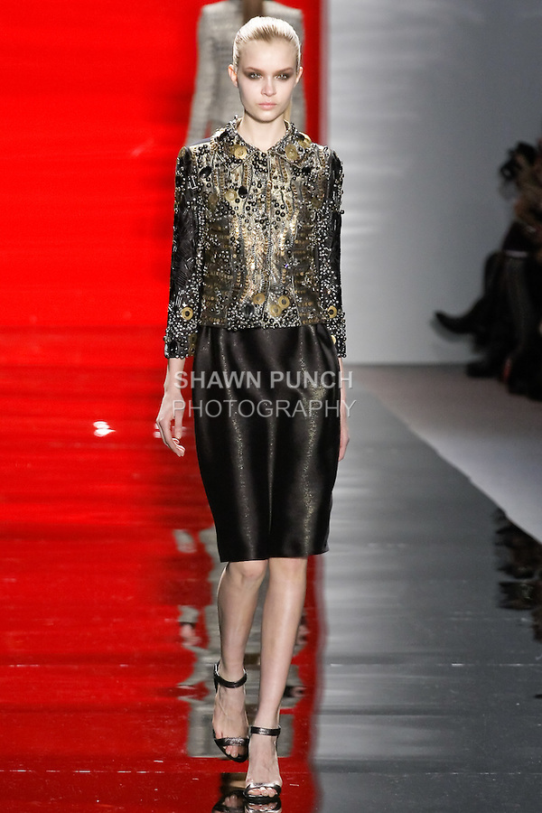 Josephine walks runway in a antique sand three-dimensional mixed media embroidered jacket with ebony metallic luster slim pencil skirt, from the Reem Acra Fall 2012 Feminine Power collection fashion show, during Mercedes-Benz Fashion Week New York Fall 2012 at Lincoln Center.