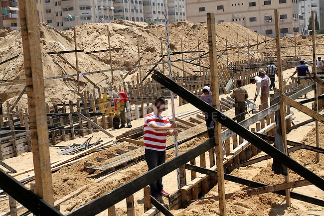 A general view taken on May 22, 2011 shows construction work on two new UN-run schools on the site of the former Palestinian security headquarters in Gaza city which was destroyed by Israel during the 2008-2009 Gaza offensive. The UNRWA (UN agency for Palestinian refugees) schools are expected to be completed within six months with a capacity of taking two thousand pupils. Photo by Mohammed Asad
