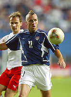 Clint Mathis eyes the ball. The USA lost 3-1 against Poland in the FIFA World Cup 2002 in Korea on June 14, 2002.