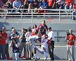Ole Miss' Donte Moncrief (12) makes a fourth quarter touchdown catch against Arkansas cornerback Isaac Madison (6) at Vaught-Hemingway Stadium in Oxford, Miss. on Saturday, October 22, 2011. .