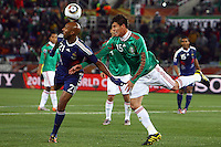 Hector Moreno (R) of Mexico and Nicolas Anelka (L) of France
