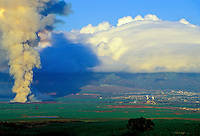 The Puunene Sugar Mill burns sugarcane on Maui