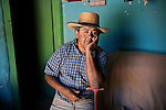 _DSC3442, BRAZIL-10036, Lambari, Brazil, 08/2010. Portrait of a man against a blue wall.<br /> <br /> retouched_Sonny Fabbri 10/29/2014