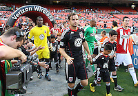 Carey Talley #8 of D.C. United and Sacha Kljestan #16 of Chivas USA enter the field during an MLS match at RFK Stadium, on May 29 2010 in Washington DC. United won 3-2.