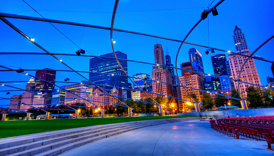 View of jay Pritzker Pavilion and Great Lawn in Millennium Park with Michigan Ave. Skyline. Multicultural events are hosted here.
