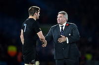 Richie McCaw of New Zealand shakes hands with RFU President Jason Leonard after the match. Rugby World Cup Final between New Zealand and Australia on October 31, 2015 at Twickenham Stadium in London, England. Photo by: Patrick Khachfe / Onside Images