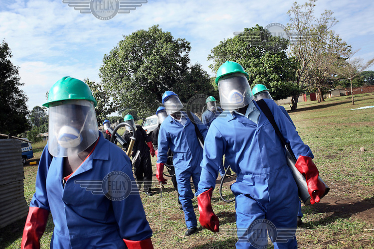 A team from the organization Malaria Consortium will spray insecticide in a school in Gulu to protect the children from malaria mosquitoes.