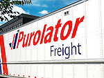 Purolator Freight truck over blue sky city background. Canada.