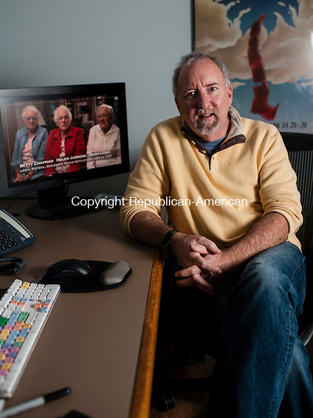 """SOUTHBURY, CT-19 December 2014-121914EC11-  Scott Sniffen sits in the editing room of his Southbury office. The filmmaker created """"Home of the Brave: When Southbury Said No to the Nazis."""" Erin Covey Republican-American"""