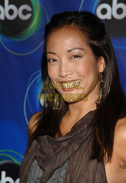 CARRIE ANN INABA.ABC 2005 Summer Press Tour Party held at the Abby, West Hollywood, California..July 27th, 2005.Photo Credit: Jacqui Wong/Admedia.headshot portrait gold hoop earrings.www.capitalpictures.com.sales@capitalpictures.com.© Capital Pictures.