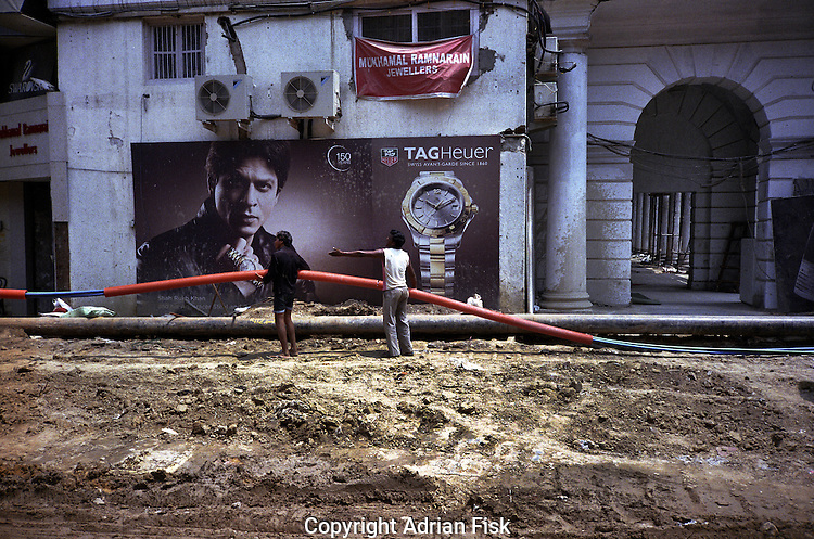 Bollywood actor Shah Rukh Khan looks on as the city is made ready for the Common Wealth games in Connaught Place, Central Delhi.