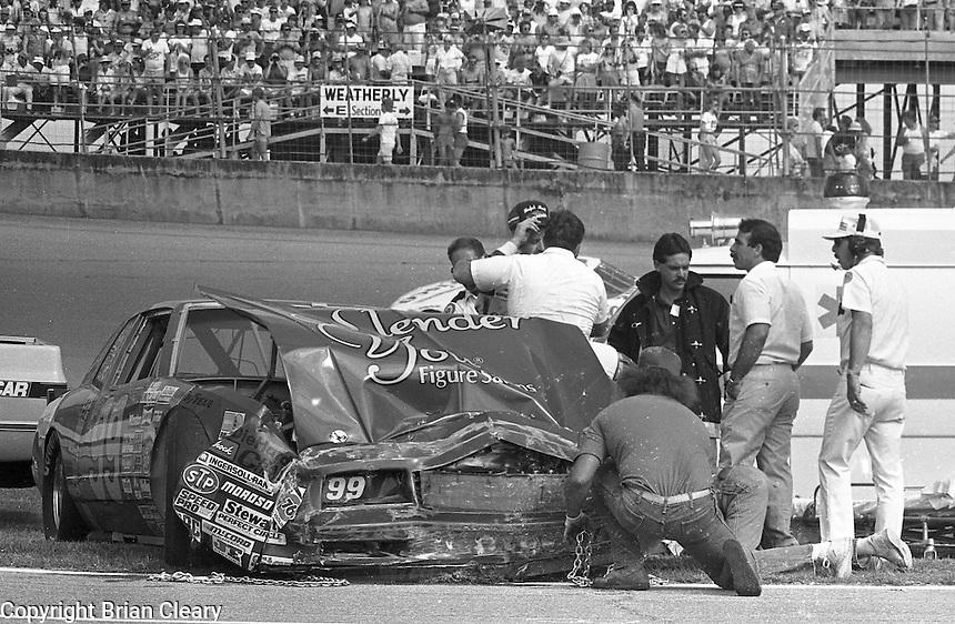 Brad Teague crash accident safety crew ambulance Pepsi Firecracker 400 Daytona International Speedway Daytona Beach FL July 1987 (Photo by Brian Cleary/www.bcpix.com)