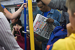 Man reading the Sun newspaper on London Underground Uk