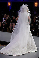 Model walks runway in a bridal gown by Walid Atallah, from the Walid Atallah Spring Summer 2012 collection, during Couture Fashion Week Spring 2012.