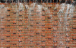 Brick with water coming down wall,