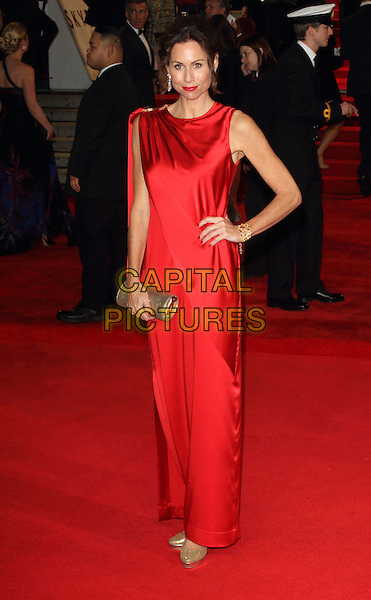Minnie Driver.Royal World Premiere of 'Skyfall' held at the Royal Albert Hall, London, England..October 23rd, 2012.full length red sleeveless silk satin dress wrap cape gold clutch bag hand on hip.CAP/ROS.©Steve Ross/Capital Pictures.